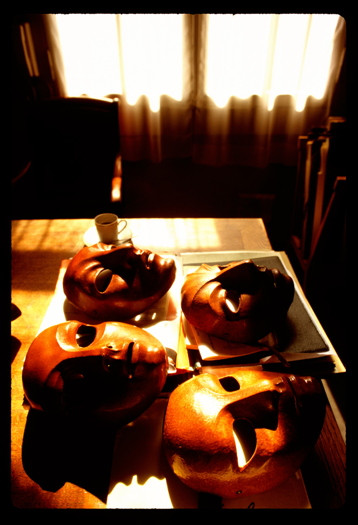 I asked if I could photograph the masks, Nothing was said. They were brought in the morning, and set upon Jacques desk, in his office, as the morniing lght graced his coffee cup. He retired with a smile to some other part of the school. Leaving me with the masks, the sun, and his coffee.